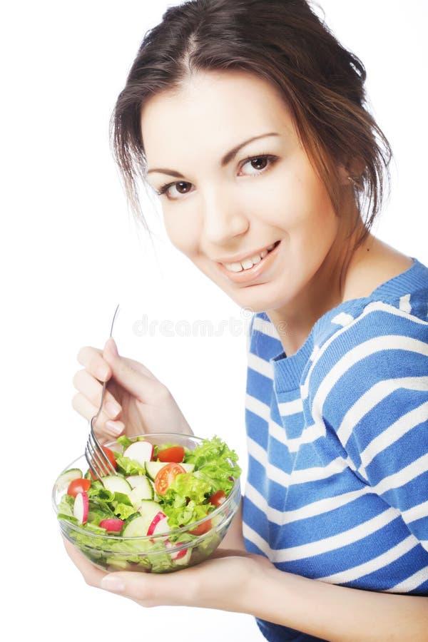 Mädchen, das gesunde Nahrung isst lizenzfreie stockfotos