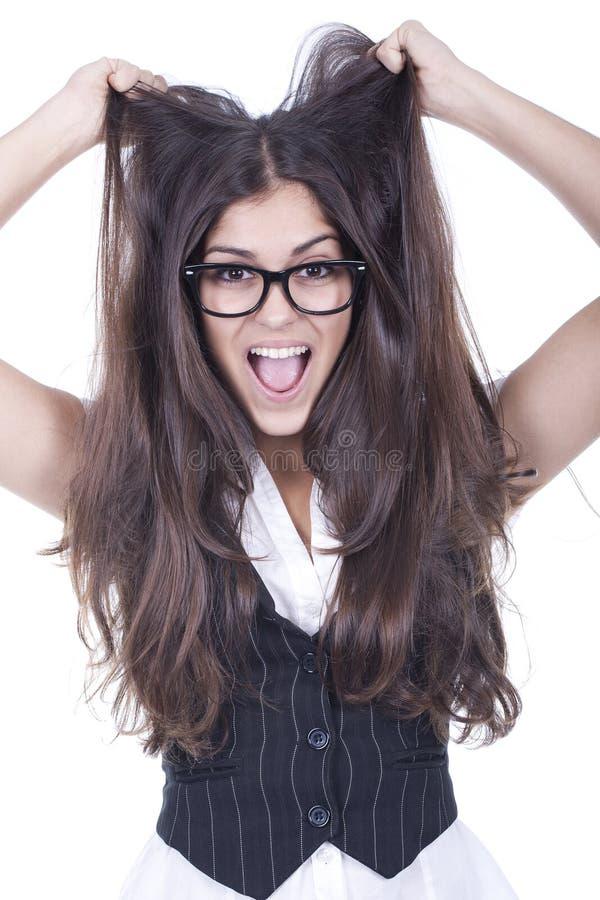 Mädchen, das Haar zieht und Spaß hat stockfotos