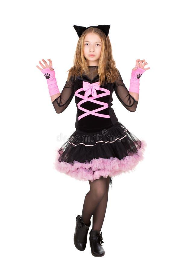 Mädchen, das im schwarzen catsuit aufwirft lizenzfreies stockbild