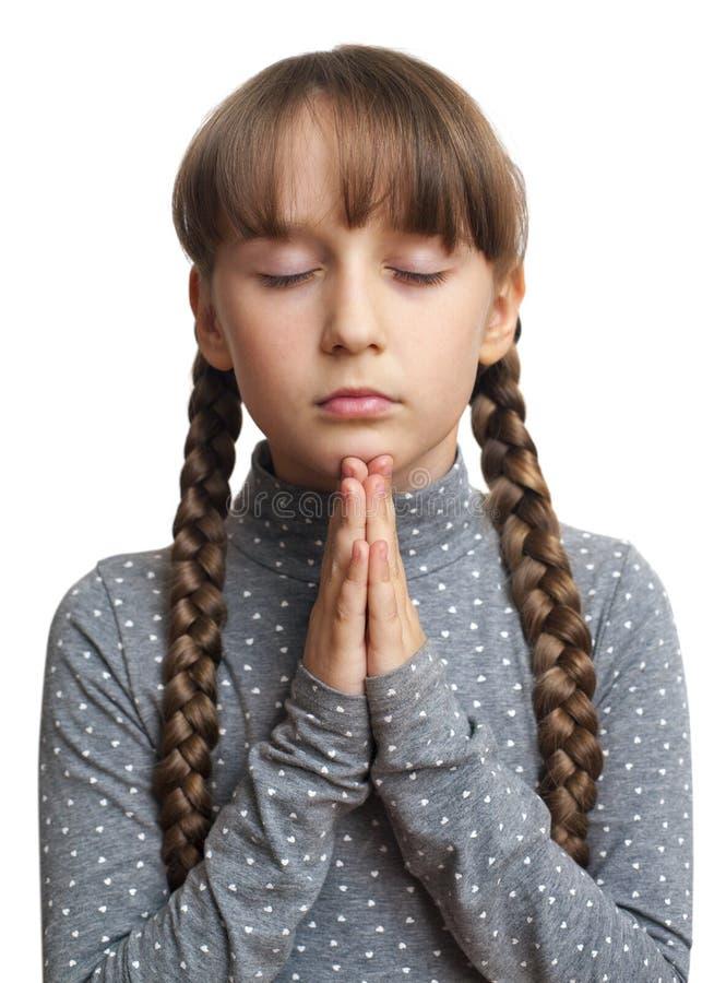 Mädchen, das, lokalisiert betet lizenzfreies stockbild