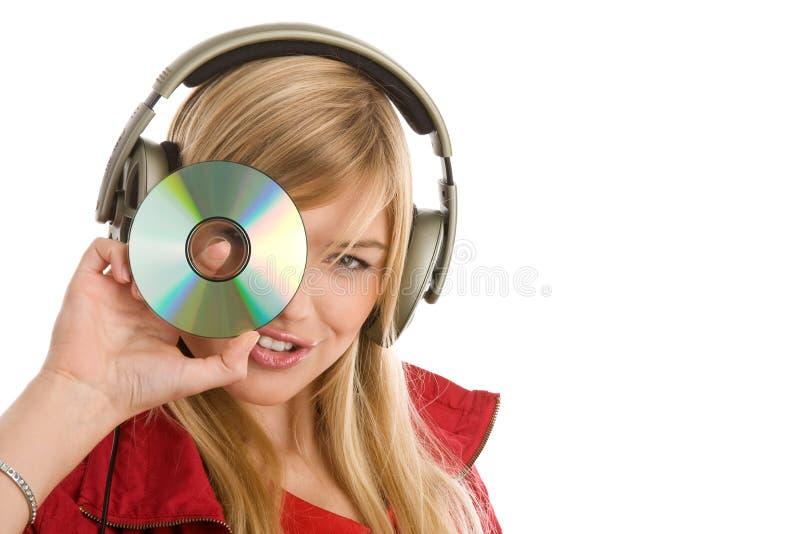 Mädchen, das Musik zeigt CD hört lizenzfreies stockfoto