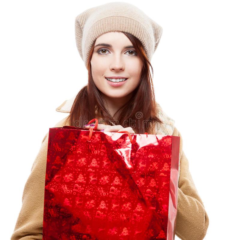 Mädchen, das rote Einkaufstasche anhält lizenzfreies stockbild