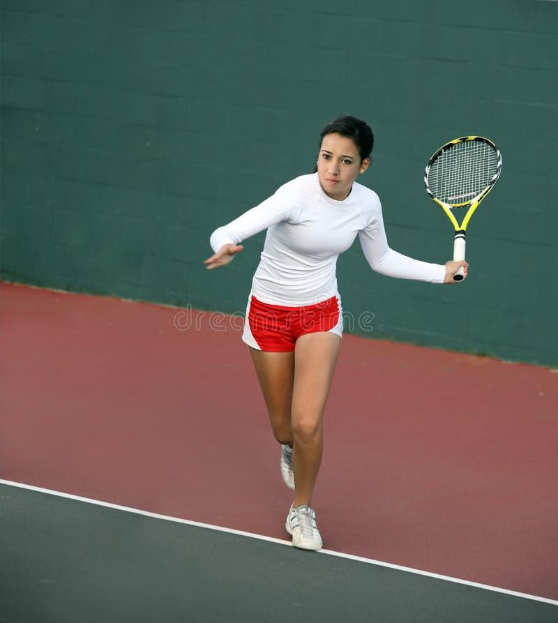 Mädchen, das Tennis spielt stockbilder