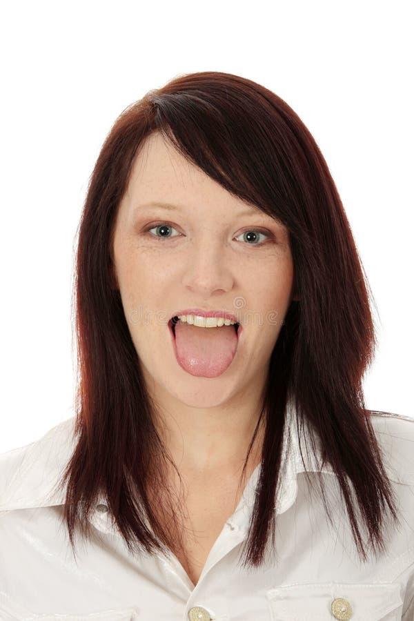 Mädchen, das Zunge zeigt   lizenzfreies stockfoto