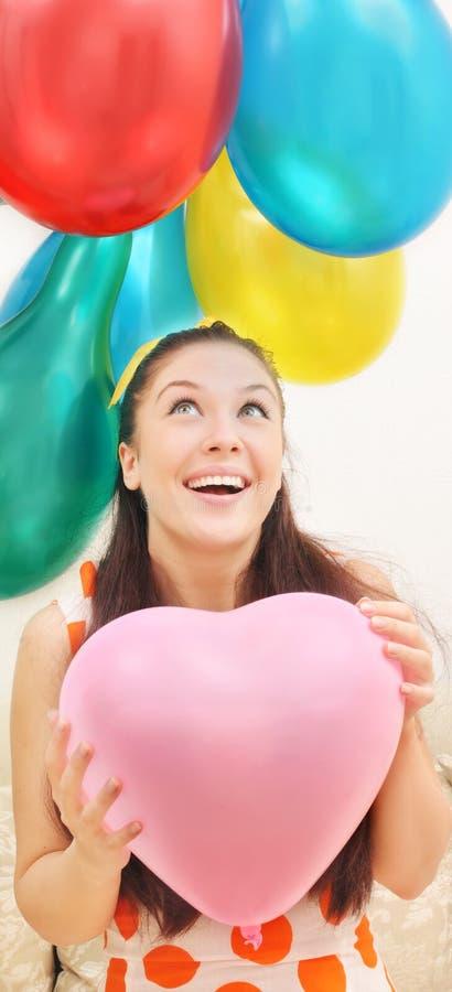 Mädchen an den Ballonen stockbilder