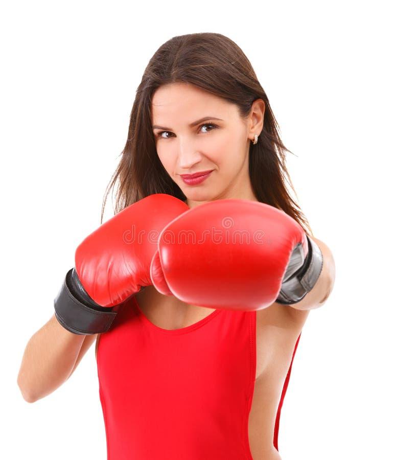 Mädchen in den Boxhandschuhen auf Weiß lokalisiertem Hintergrund stockfotografie