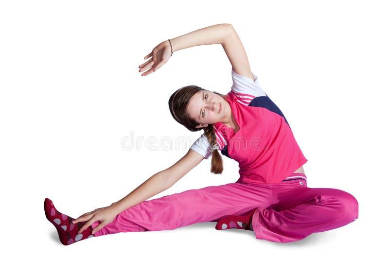 Mädchen in den rosafarbenen activewear tuneignungübungen lizenzfreie stockfotografie