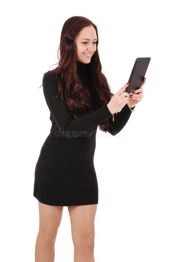 Mädchen in der Bewegung, die Tablet-Computer betrachtet lizenzfreies stockbild