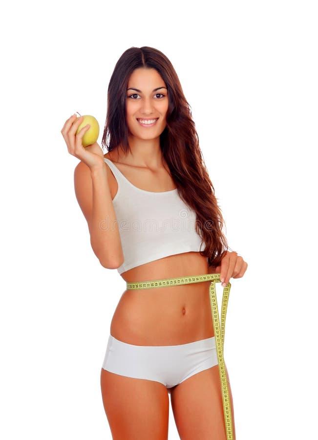 Mädchen in der weißen Unterwäsche mit einem Maßband und einem Apfel lizenzfreie stockfotos