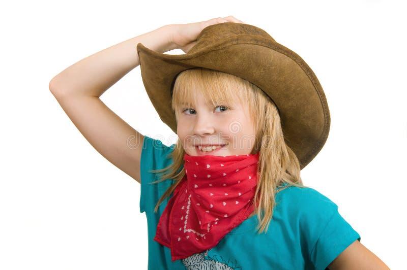 Mädchen in einem Cowboyhut stockfotos