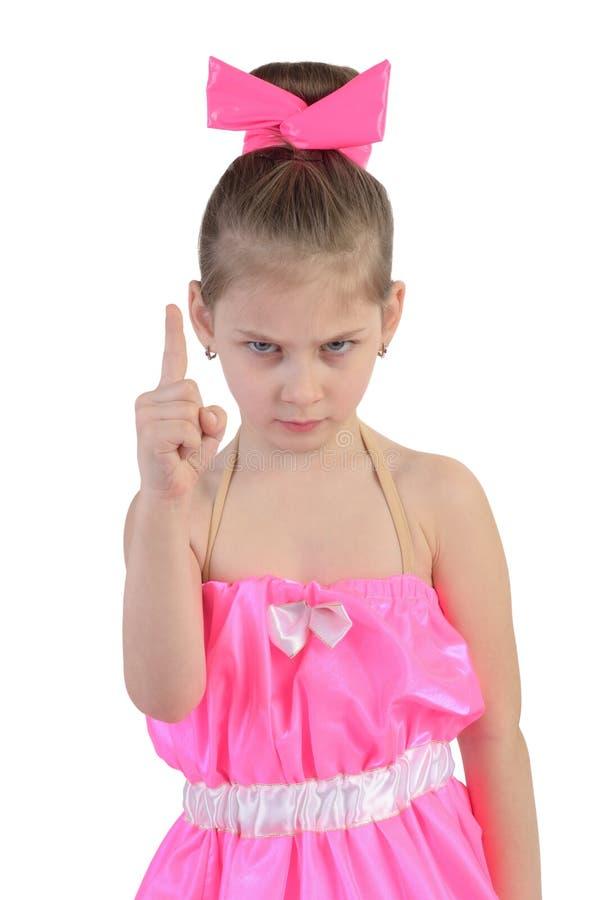 Mädchen in einem hellen Kleidergesichtsfinger stockbild