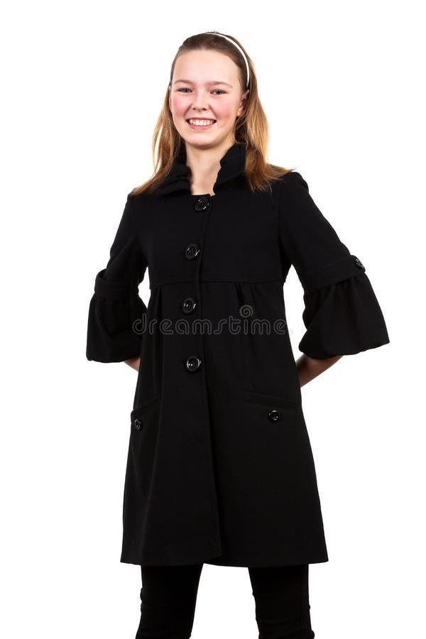 Mädchen in einem Mantel lizenzfreie stockfotografie