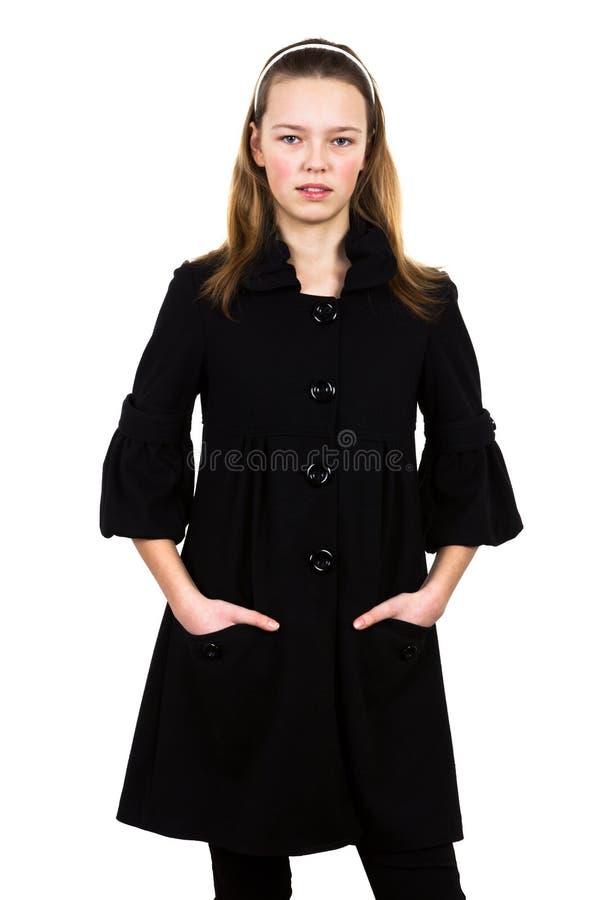 Mädchen in einem schwarzen Mantel stockfotos