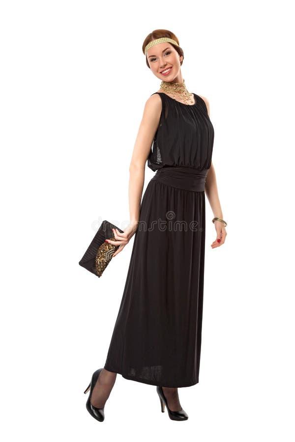 Mädchen in einem schwarzen Retro- Kleid stockfotografie