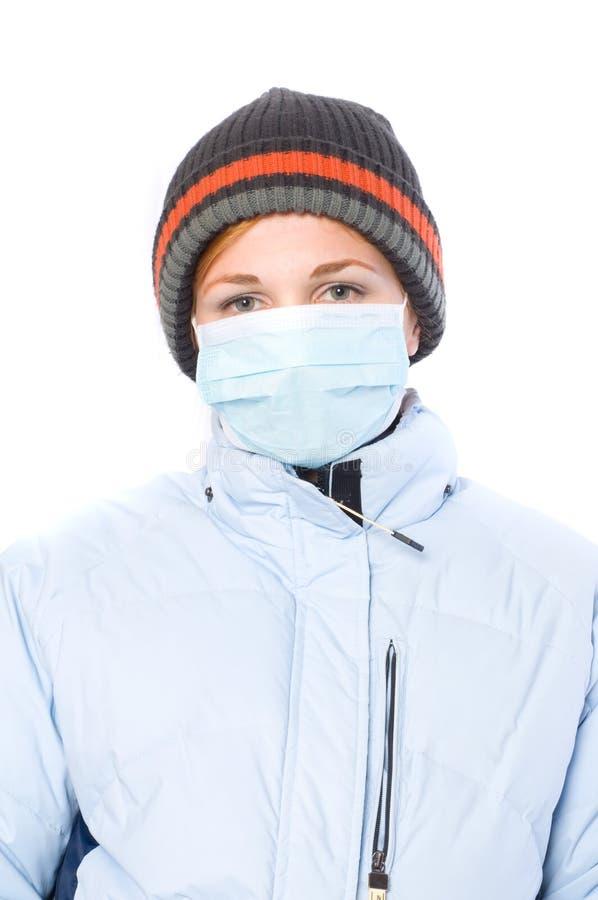 Mädchen in einer Schablone. Epidemie. H1N1 lizenzfreie stockfotos