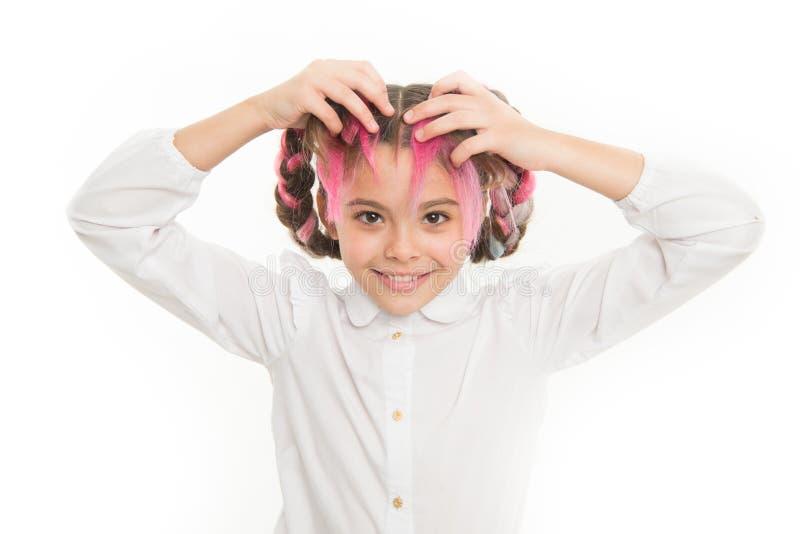 Mädchen flicht lang weißen Hintergrund Halten Sie Haar geflochten für sauberen Blick Kinderschülerspiel mit dem langen umsponnene stockfotos