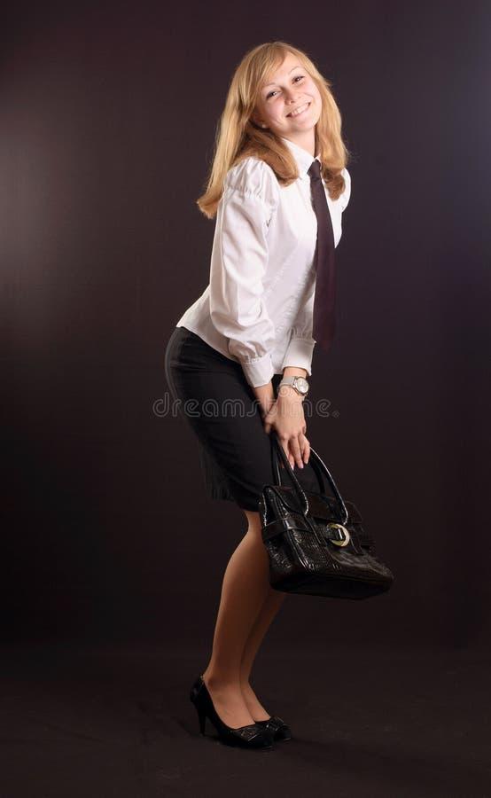 Mädchen gekleidet als Geschäftsdame lizenzfreie stockfotos