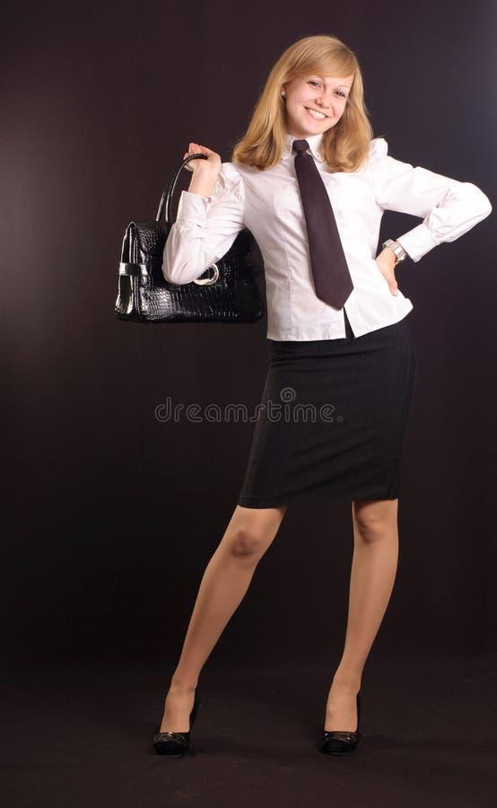 Mädchen gekleidet als Geschäftsdame stockfotos