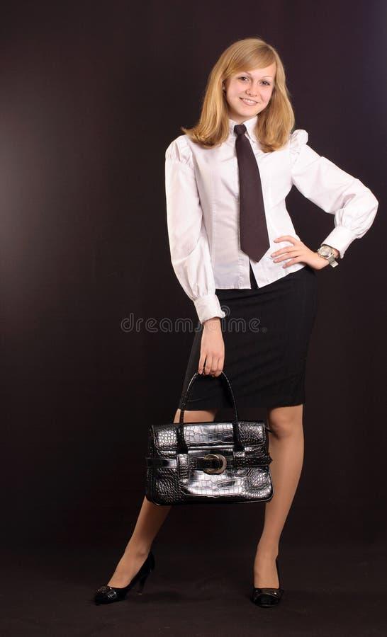 Mädchen gekleidet als Geschäftsdame lizenzfreie stockbilder