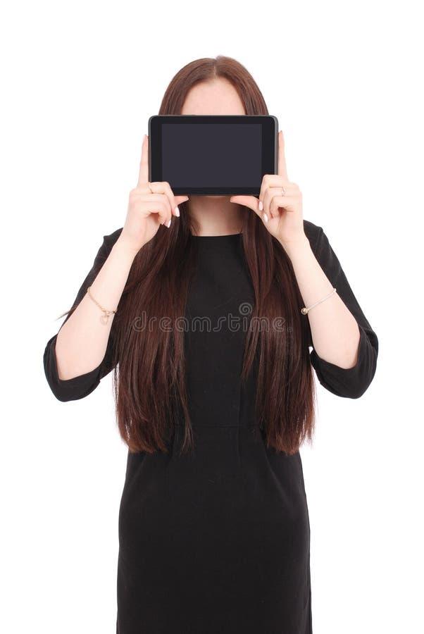 Mädchen hält Tabletten-PC das Gesicht stockfoto