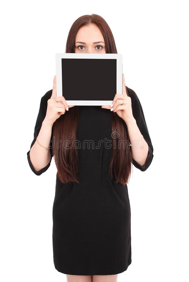Mädchen hält Tabletten-PC das Gesicht lizenzfreie stockfotos