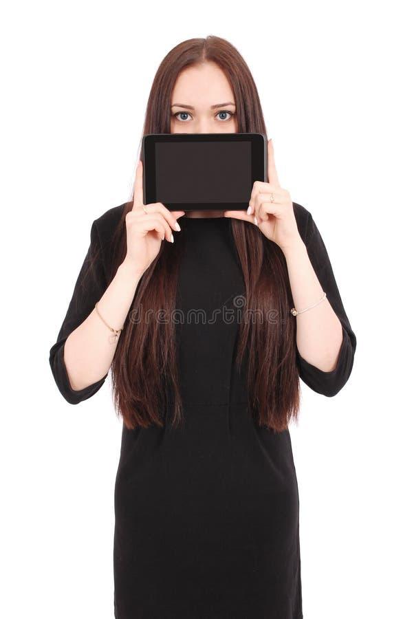 Mädchen hält Tabletten-PC das Gesicht lizenzfreies stockfoto
