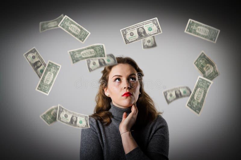 Mädchen im Grau und in den Dollar stockbilder