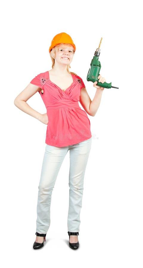 Mädchen im harten Hut mit Bohrgerät lizenzfreie stockfotografie