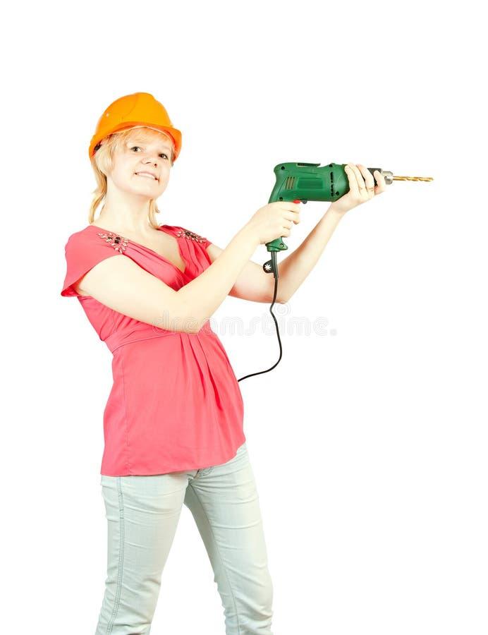 Mädchen im harten Hut mit Bohrgerät stockfotos