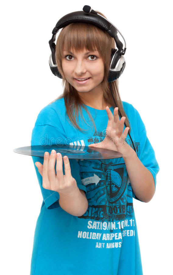 Mädchen im Kopfhörer mit Vinylplatte stockfotografie