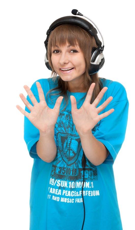 Mädchen im Kopfhörer zeigt Palme lizenzfreie stockfotografie