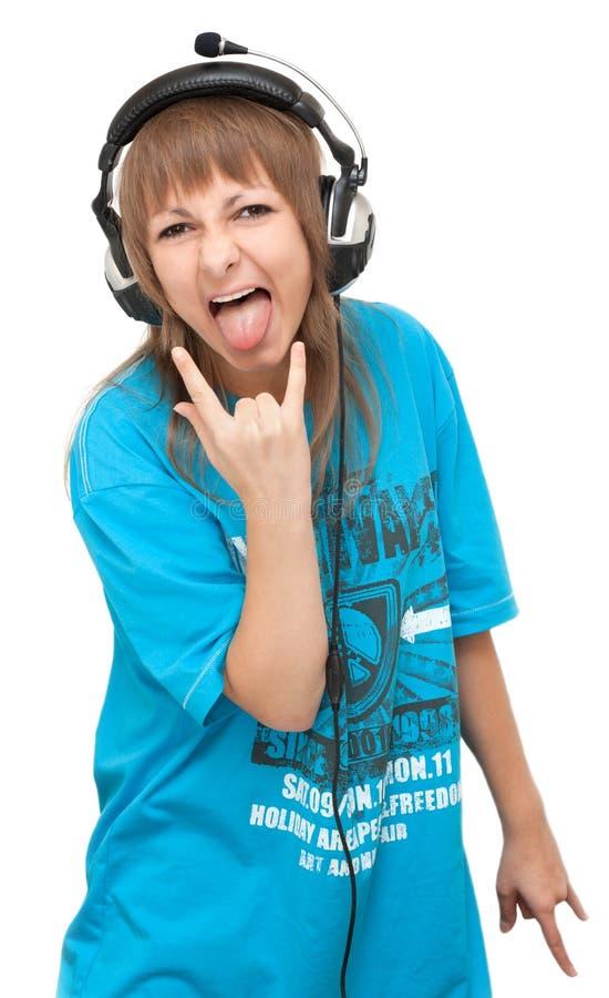 Mädchen im Kopfhörer zeigt Sprache lizenzfreie stockfotos