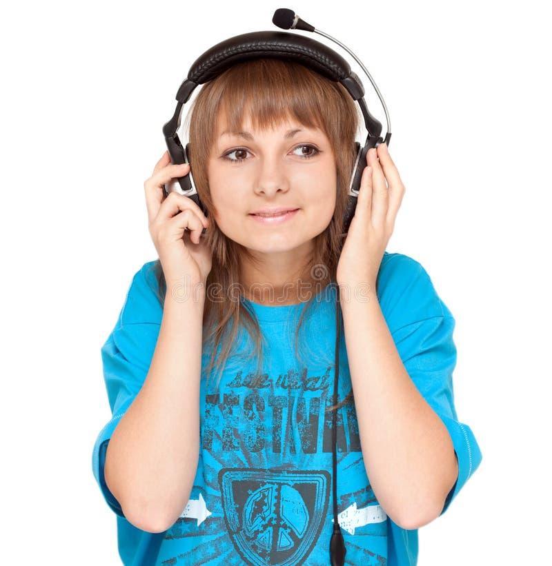 Mädchen im Kopfhörerlächeln, Portrait lizenzfreie stockbilder