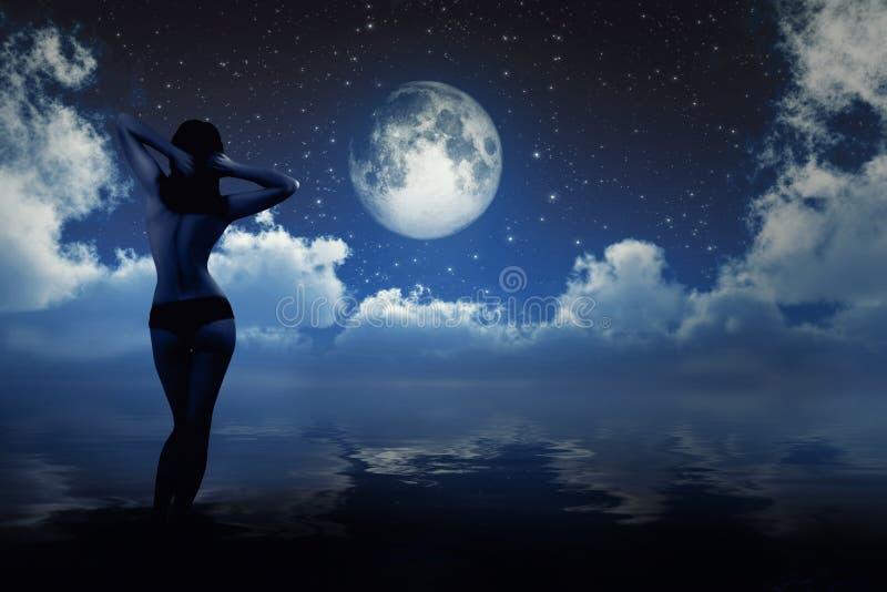 Mädchen im Mondschein stockfotografie