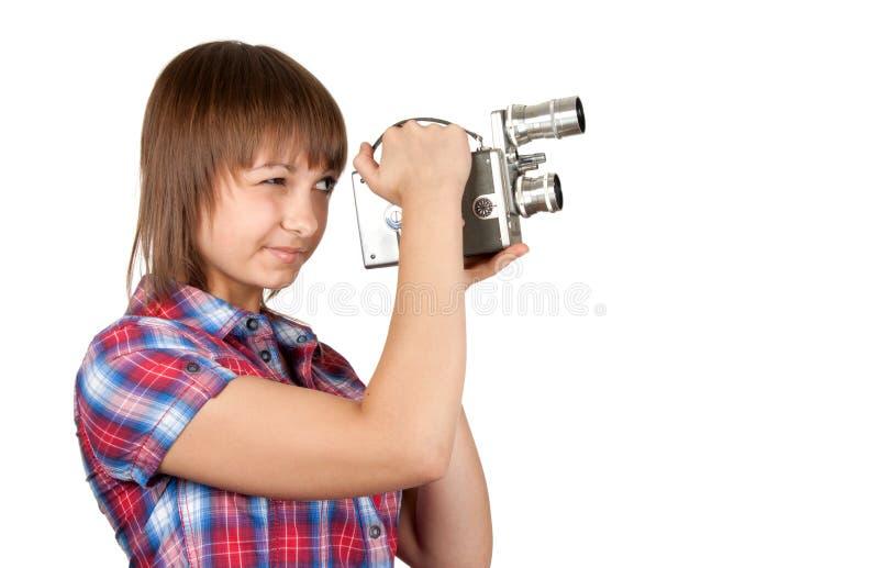 Mädchen im Plaidhemd mit Filmkamera lizenzfreies stockfoto