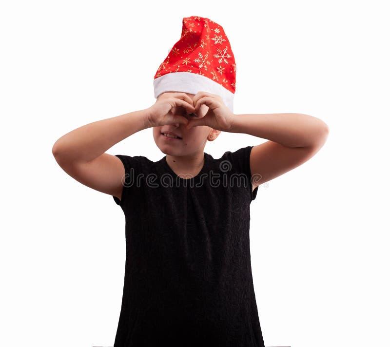 Mädchen im roten Weihnachtshut lizenzfreie stockbilder
