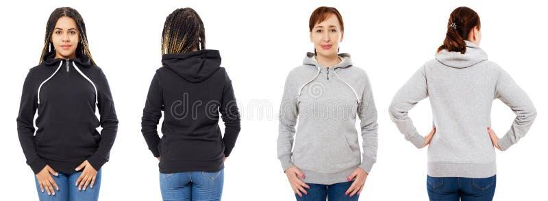 Mädchen im stilvollen schwarzen Hoodie lokalisiert auf weißem Hintergrund: Mädchen in der grauen Haubenfront und in der hinteren  stockbilder