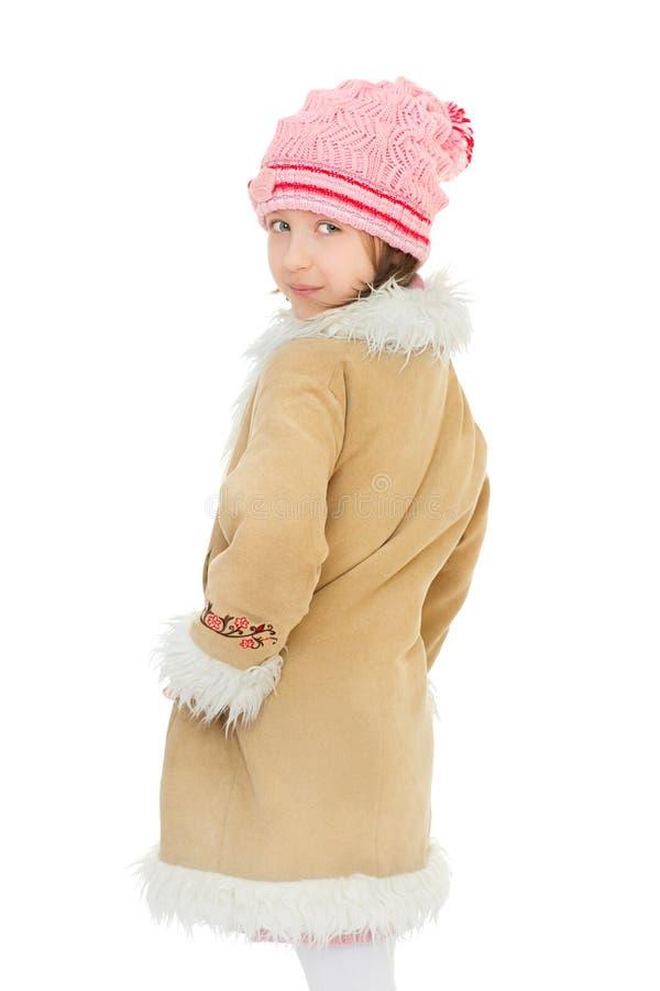 Mädchen im Wintermantel lizenzfreie stockbilder