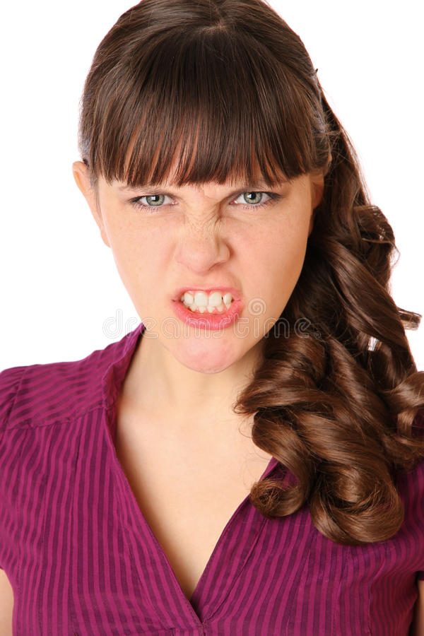 Mädchen ist verärgert und Grinsen stockbild