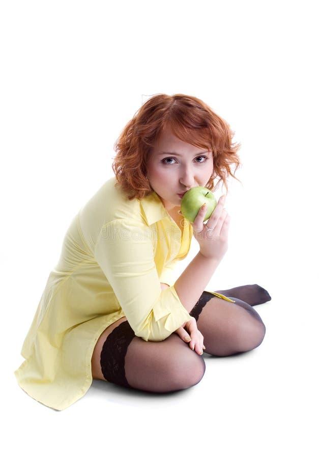 Mädchen mit Apfel stockfoto