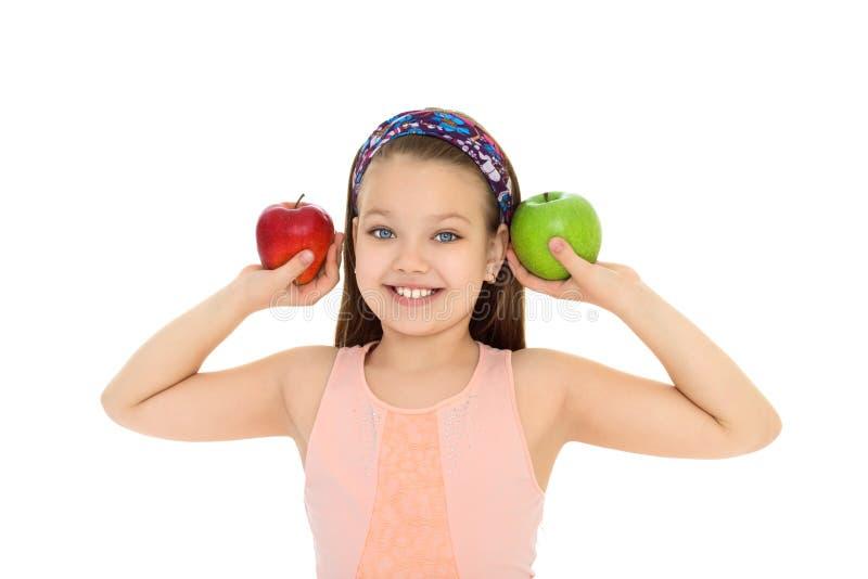Mädchen mit Apple in den Händen lizenzfreie stockfotografie