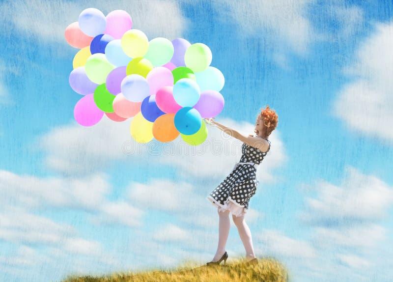Mädchen mit Ballonen stockbild