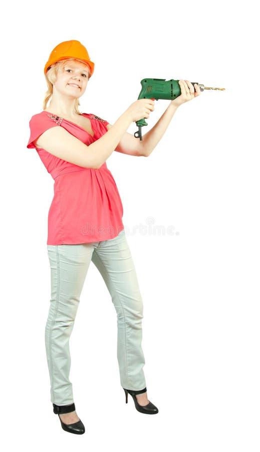 Mädchen mit Bohrgerät stockfotos