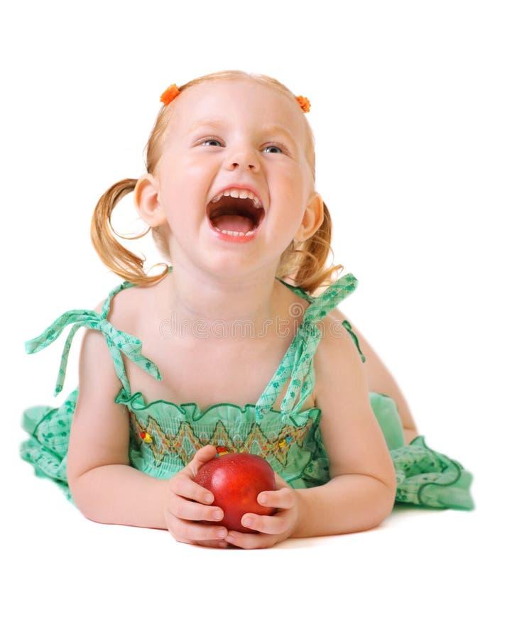 Mädchen mit dem Pfirsich getrennt auf Weiß stockbild