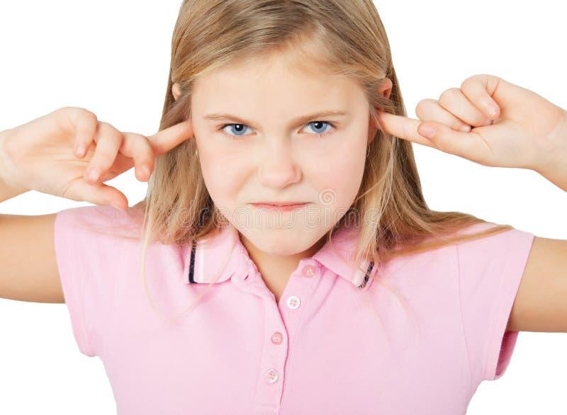 Mädchen Mit Den Fingern In Den Ohren Stockbild - Bild von