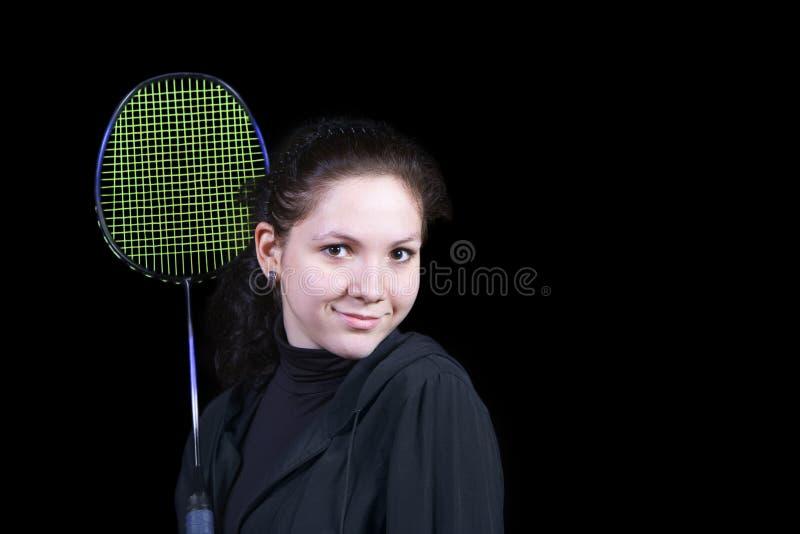 Mädchen mit einem Federballschläger stockbilder