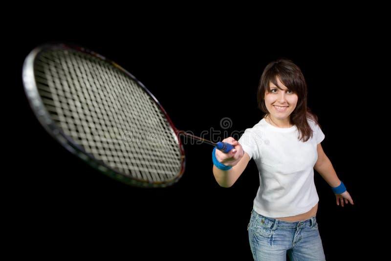 Mädchen mit einem Federballschläger lizenzfreies stockbild