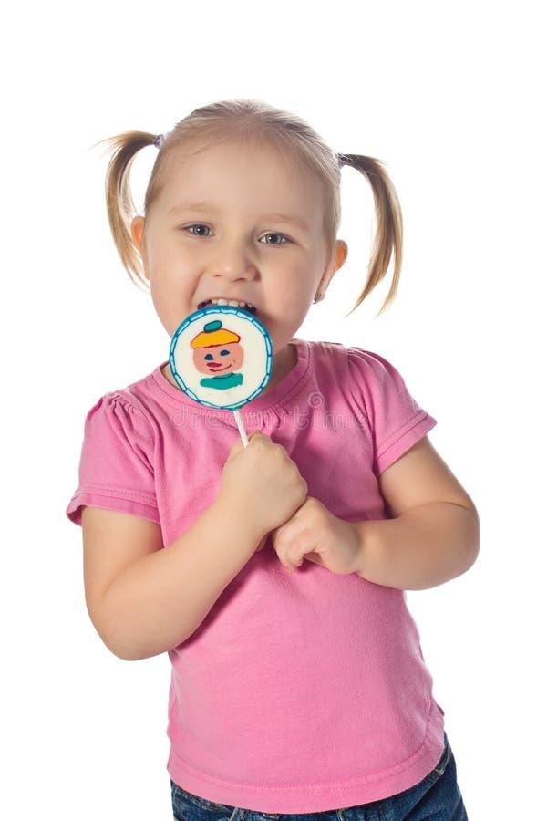 Mädchen mit einem Lutscher stockbilder