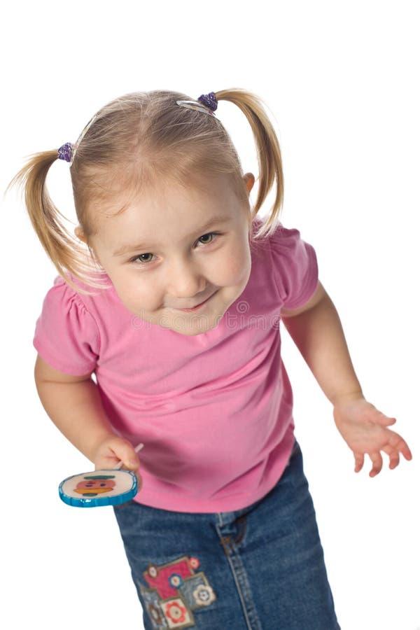 Mädchen mit einem Lutscher stockfoto