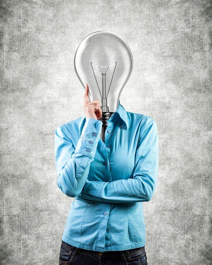 Mädchen mit einer Glühlampe lizenzfreies stockbild